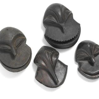 Four masks of carved patinated wood. Hemba style. H. 15–17 cm. (4)