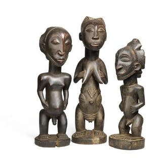 Three ancestor figures of carved patinated wood. Hemba style. H. 41–49 cm. (3)