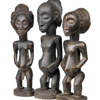 Three figures of carved patinated wood. Hemba style. H. 50–55 cm. (3)