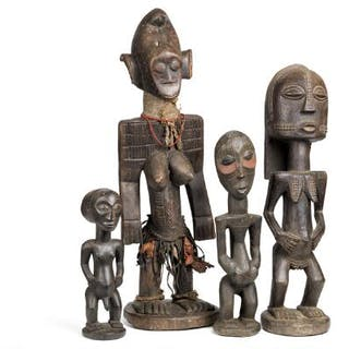 Four ancestor figures of carved patinated wood