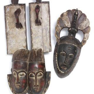 Double mask of carved patinated wood with traces of...
