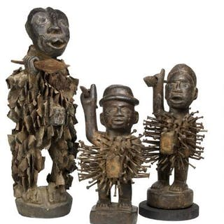 Three nail fetish figures of carved patinated wood...