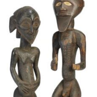 Two large ancestor figures of carved patinated wood