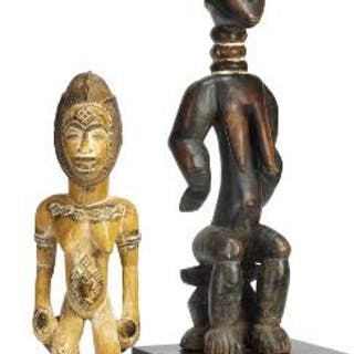 Two ancestor figures of carved patinated wood with traces of white kaolin