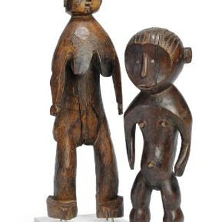 Two ancestor figures of carved patinated wood