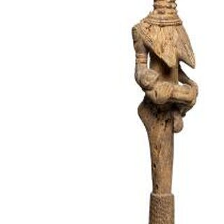 Figure of carved