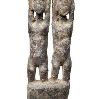 Double-figure of carved wood adorned with sacrificial...