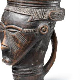 Cup of carved black patinated wood. Kuba, D. R. Congo. H. 20 cm.