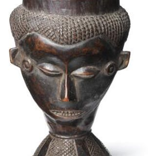 Cup of carved black patinated wood. Kuba, D. R. Congo. H. 15 cm.