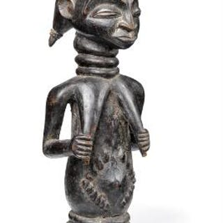 Fertility figure of carved black patinated wood. Luba style. H. 27 cm.