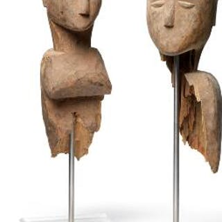 Two figural fragments of carved patinated and weathered...
