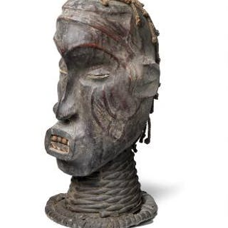 Headdress of carved patinated wood clad with patinated animal hide