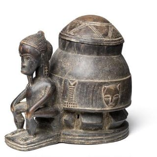 Mouse oracle depicting a sitting male figure carved of patinated wood