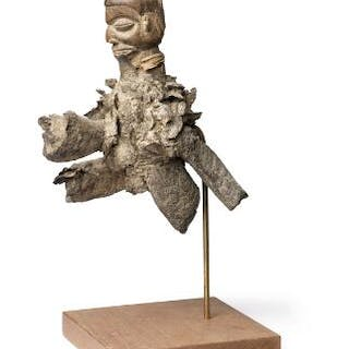 Fetish figure of carved patinated wood decorated with horns