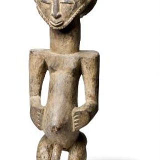 Ancestor figure of carved patinated wood, Hemba style. H. 45 cm.
