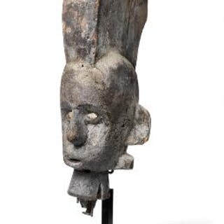 Head of carved patinated wood. Igbo, Nigeria. H. excl. base app. 42 cm.
