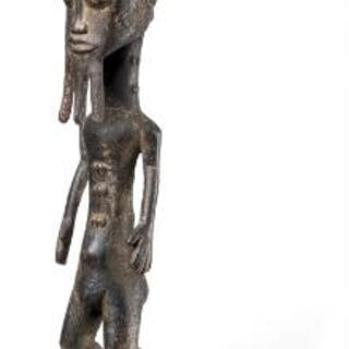 Blolo bian of carved patinated wood. Baulé, Ivory Coast. H. excl. base 48 cm.