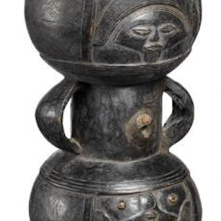Drum of carved patinated wood with handles/arms. Chokwe, D. R. Congo. H. 49 cm.