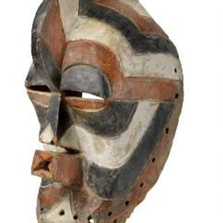 Mask of patinated wood decorated with red