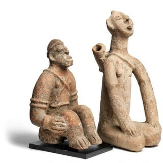 Two seated terracotta figures. Djenné style. H. 29 and 35 cm. (2)