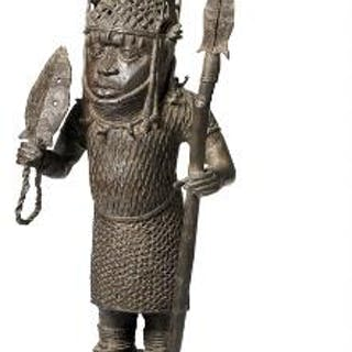 Altar figure of patinated bronze holding spear. Benin style. H. app. 109 cm.