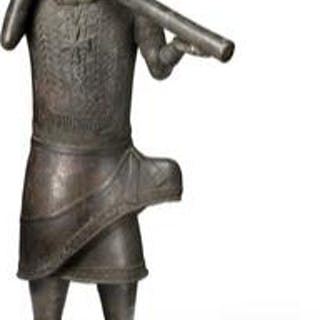 Altar figure of patinated bronze holding flute. Benin style. H. app. 114 cm.