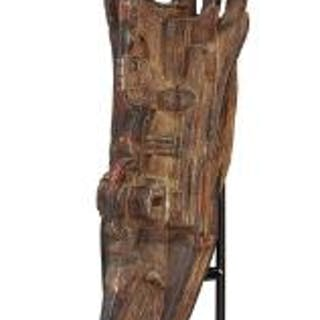 Large mask of carved patinated wood with traces of black