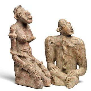 Two seated terracotta figures. Djenné style. H. 27 and 35 cm. (2)