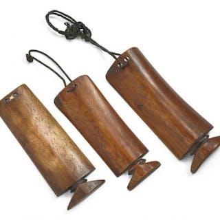 Three amulets of carved patinated bone, Lobi style. H. 17–19 cm. (3)