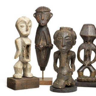 A collection of four ancestor figures of carved patinated wood