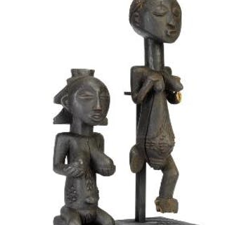 Two ancestor figures of carved patinated wood. Luba style. H. 41 and 56 cm. (2)