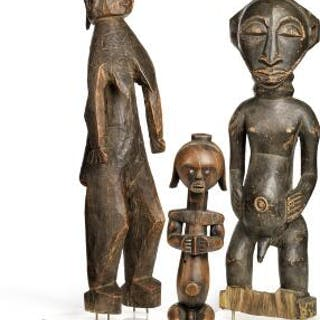 Two ancestor figures and a guardian figure of carved patinated wood