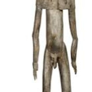 Large ancestor figure of carved patinated wood