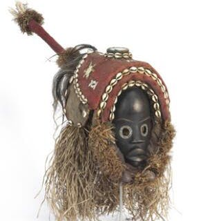 Mask of carved patinated wood mounted with fabric
