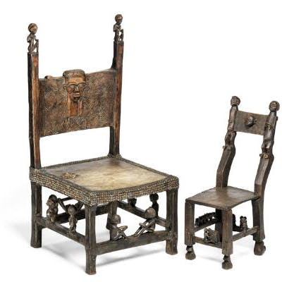 Two chairs of carved patinated wood