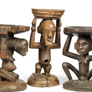Three stools of carved patinated wood. Luba and Songye style. H. 31–40 cm. (3)