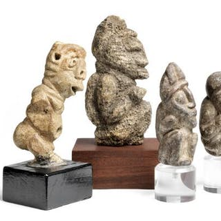 Four figures of carved stone mounted on base of wood and plexiglass