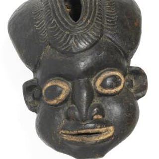 Large helmet mask of carved patinated wood with white pigment