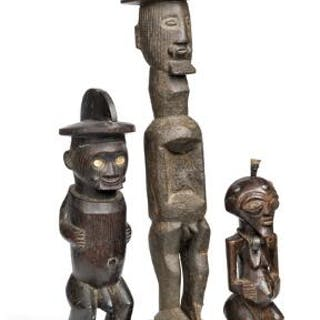 Three fetish figures of carved patinated wood
