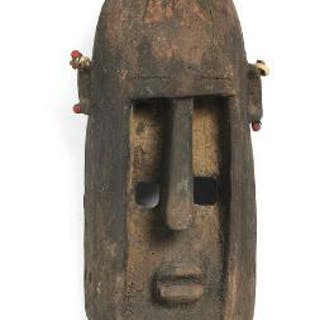 Mask of carved patinated wood