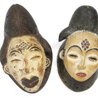 Two masks of carved patinated wood clad with kaolin and red pigment