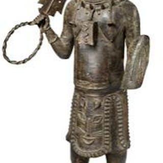 Altar figure of patinated bronze holding sword and shield