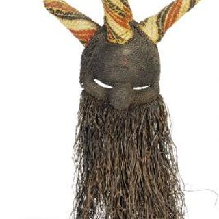 Selampasu mask of braided material with five horns decorated with red