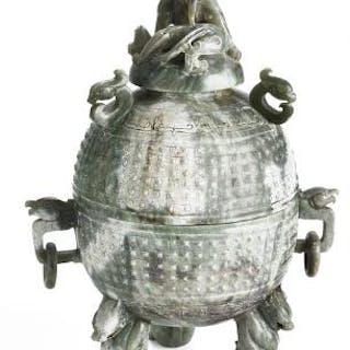 A Chinese lidded bowl of green and greyish jade