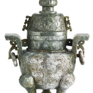 A Chinese covered vase of greenish jade