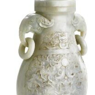 A Chinese covered vase of whitish jade carved with ring...