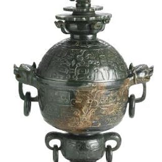 A Chinese sphere-shaped covered vase of green jade. Weight 2614 g. H. 42 cm.