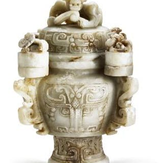A Chinese covered vase of whitish jade. Weight 4835 g. H. 27 cm.