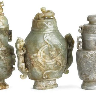 Three Chinese covered vases of green and grey jade carved with chilong dragons