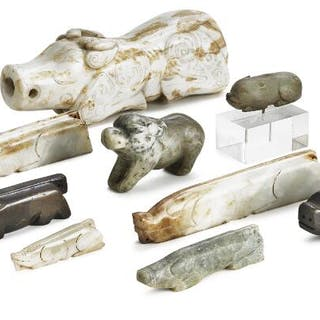 Nine Chinese figurines of jade carved in the shape of pigs